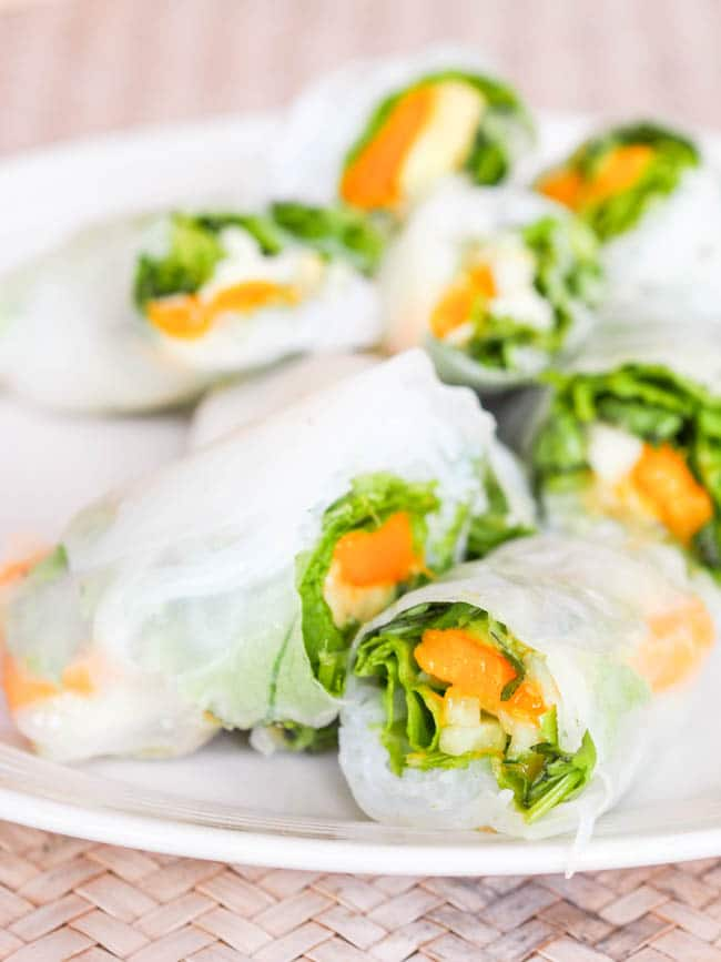 Vegan Mango Summer Rolls with Avocado make for the most refreshing appetizer. Creamy mango and lightly sweet and soft mango wrapped up with greens and herbs in silky rice paper wrappers. Gluten Free too.