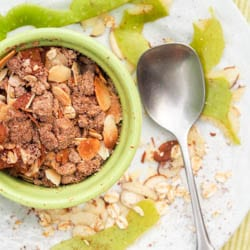 Spice up a traditional gluten free apple crisp by making it vegan and adding butternut squash into the mix! Topped with a delicate crumble of oats, brown sugar, cocoa powder, almonds and olive oil. Even more depth of flavor here!