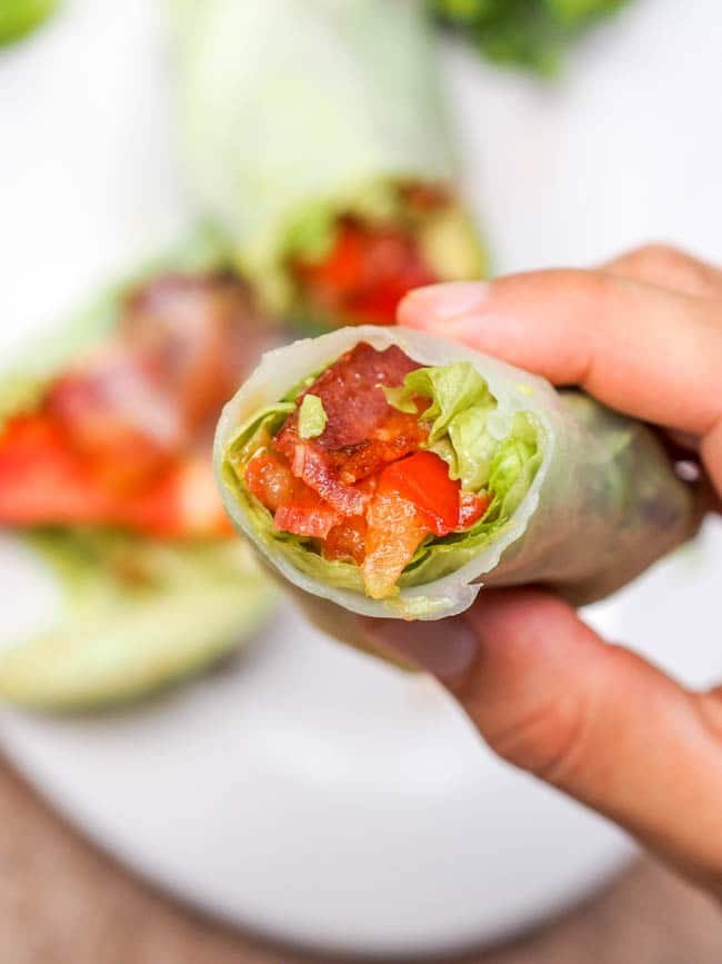 BLT Lettuce Wraps wrapped up in rice paper and ready to eat