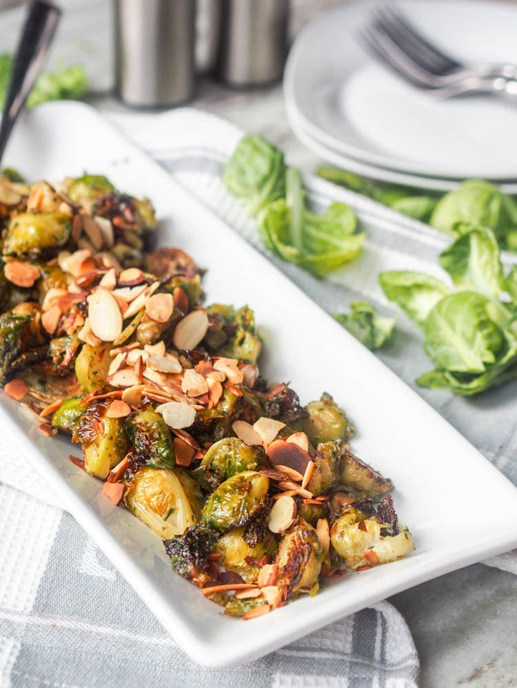 Vegan Roasted Pesto Brussel Sprouts served topped with sliced almonds