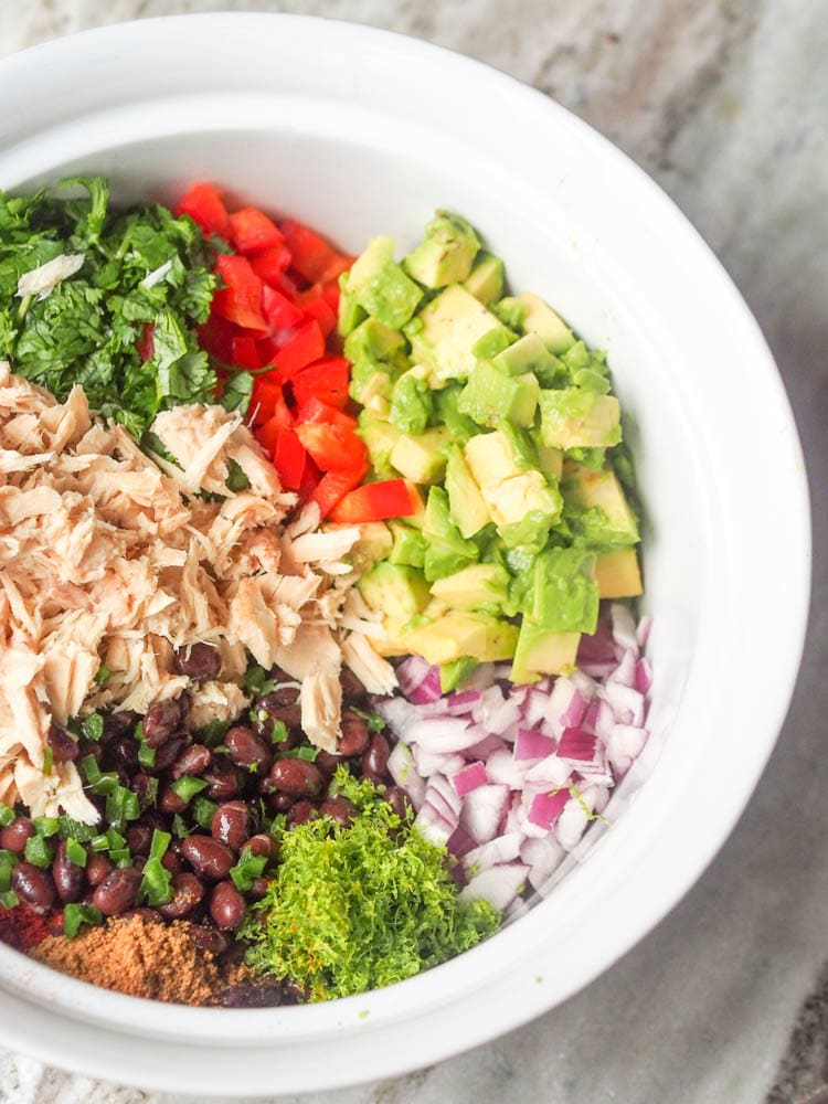 Mexican Tuna Salad ingredients mixed together in a bowl