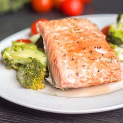 5 Ingredient Oven Poached Salmon with Cherry Tomatoes and Broccoli makes for the perfect quick and easy weeknight dinner. Ready in 30 minutes with minimal clean up. Gluten Free, Dairy Free and can be made Paleo.