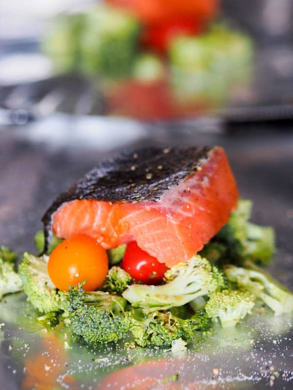 Broccoli with cherry tomatoes, Topped with oven poached salmon