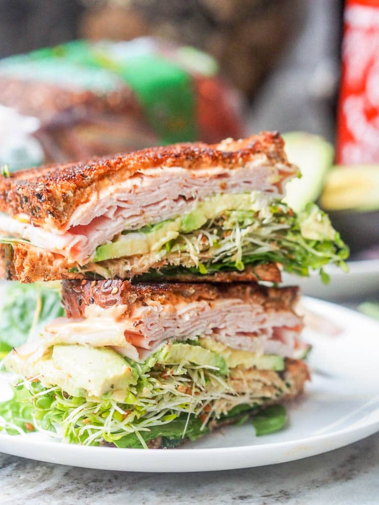 The best turkey, arugula, alfalfa and avocado sandwich you'll ever eat. Topped with a spicy Sriracha Aioli. Lunch is served. Gluten Free + Dairy Free too. |avocadopesto.com