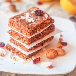 These vegan energy bars with coconut flakes, macadamia nuts, dried cranberries, lemon and dates make for the perfect mid afternoon snack. GF and Refined Sugar Free. Ready in 15 mins.