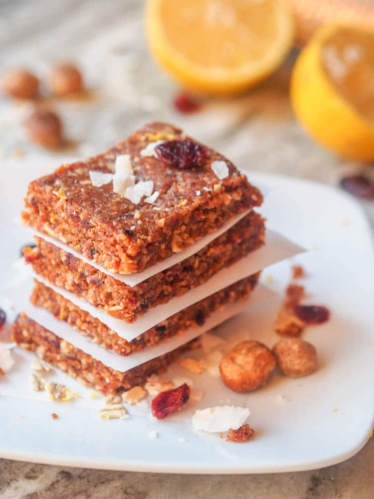 vegan energy bars with coconut flakes, macadamia nuts, dried cranberries, lemon and dates