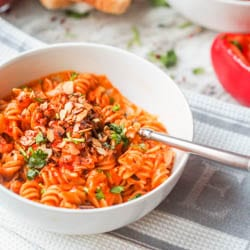 Skip the tomato sauce and make vegan roasted red pepper pasta instead. A whole depth of flavor and made to be super creamy with the addition of coconut milk. GF.
