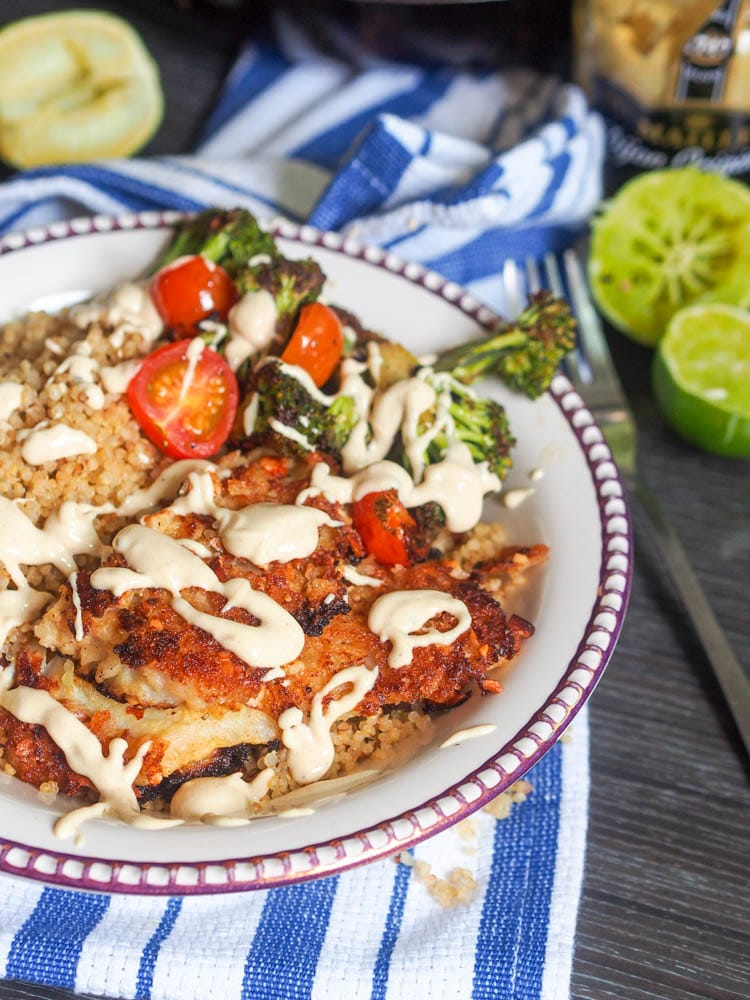 Panko crusted fish with almonds, quinoa, veggies and topped with a  tahini mustard sauce