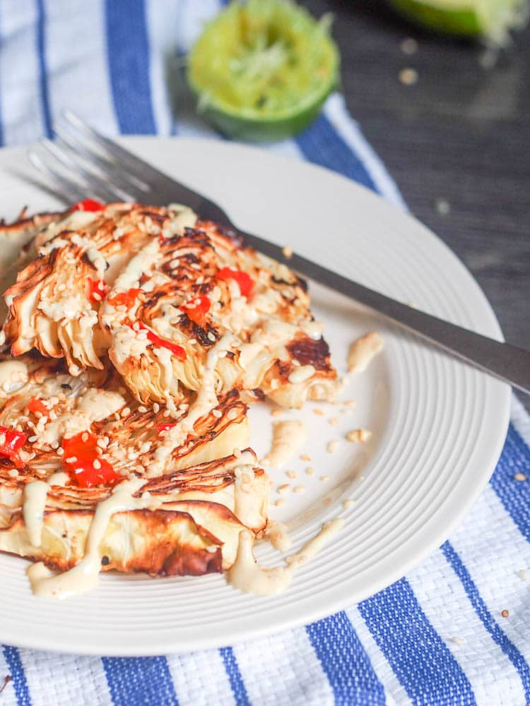 Vegan Cabbage Steaks with Tahini Sauce and chili ready to eat
