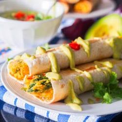 Vegan Taquitos with Lentils, Squash, Arugula and Avocado Crema