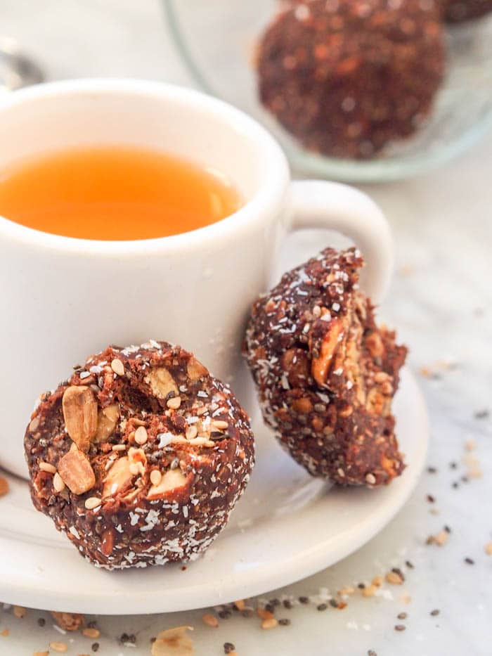 vegan chocolate balls with a cup of tea