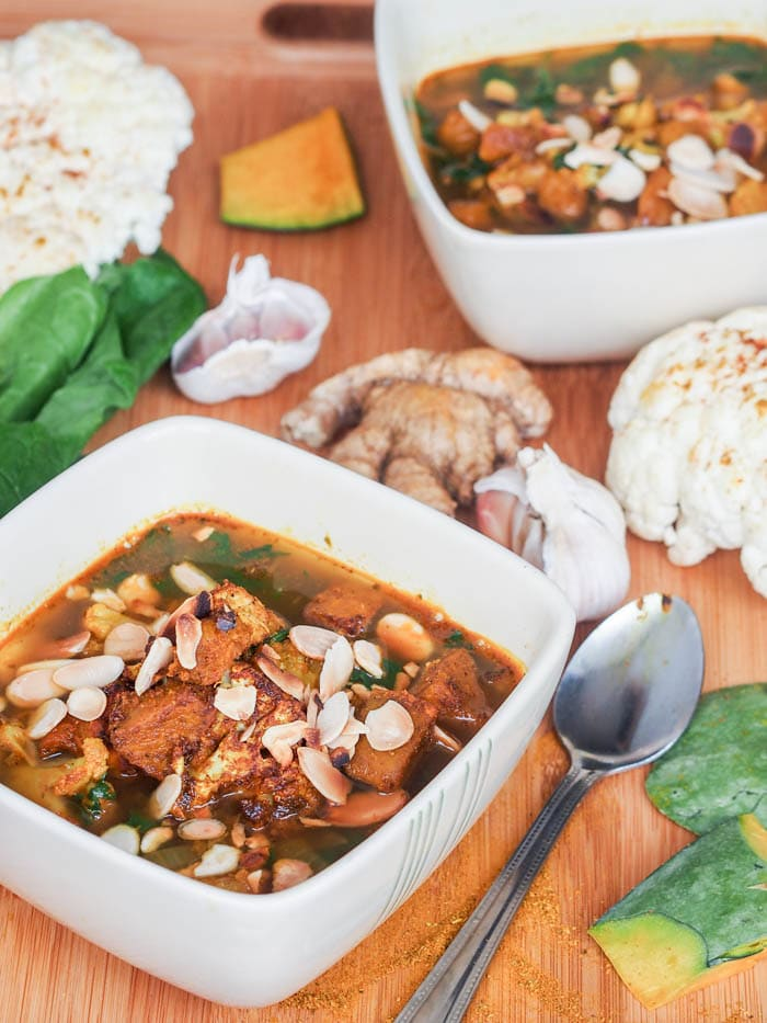 A 45 minute super comforting and hearty vegan curried paprika roasted pumpkin and cauliflower soup with spinach and almonds. Healthy and delicious. Gluten Free too. | avocadopesto.com