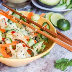 This Vegan Asian Cucumber Carrot Ribbon Salad is made with thin slivers of cucumbers, avocados and carrots, topped with a creamy home made ginger carrot dressing, toasted sesame seeds and Sriracha. Fresh and healthy! Gluten Free too. | avocadopesto.com