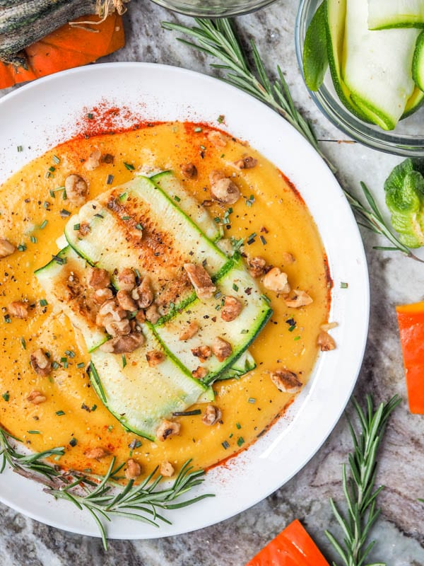 Your favorite fall pumpkin rosemary flavors topped with a vegan ricotta stuffed zucchini ravioli and sprinkled with toasted walnuts. Dinner doesn't get better than this. Low Carb + Gluten Free too. | avocadopesto.com
