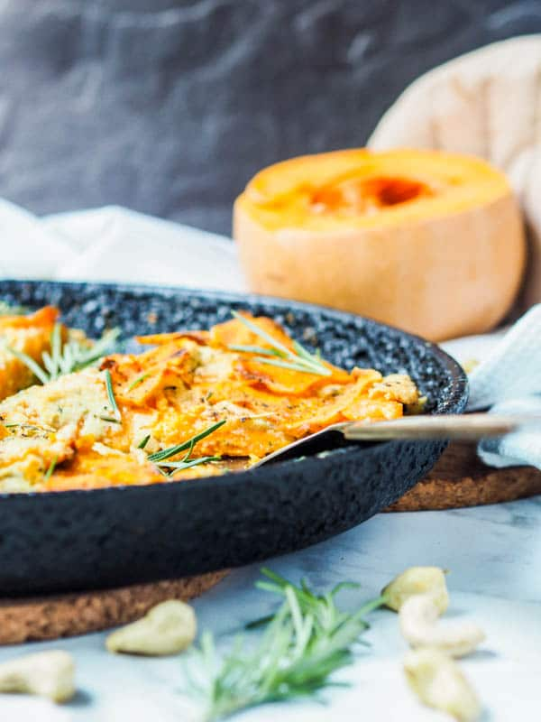 Butternut squash gratin in a cast iron pan