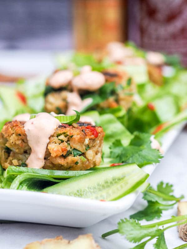 Easy Crab Cakes on lettuce cups with spicy Asian aioli