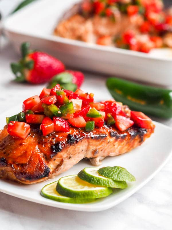 strawberry salmon with jalapeños plated with strawberry jalapeno salsa