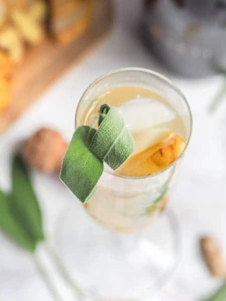 Winter Prosecco Cocktails garnished with sage leaves