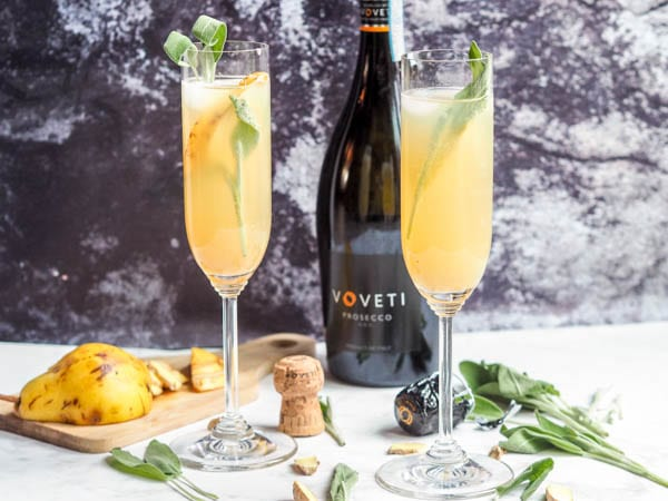 Prosecco Cocktails with Sage Pear Ginger made with voveti prosecco garnished with sage