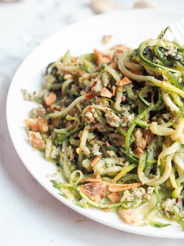 Whole 30 pesto, paleo, gluten-free, dairy-free and low carb zucchini noodle pasta with pesto and chicken makes for the perfect healthy weeknight dinner. Ready in 30 minutes.