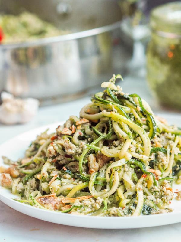 Whole30, paleo, gluten-free, dairy-free and low carb zucchini noodle pasta with pesto and chicken makes for the perfect healthy weeknight dinner. Ready in 30 minutes.
