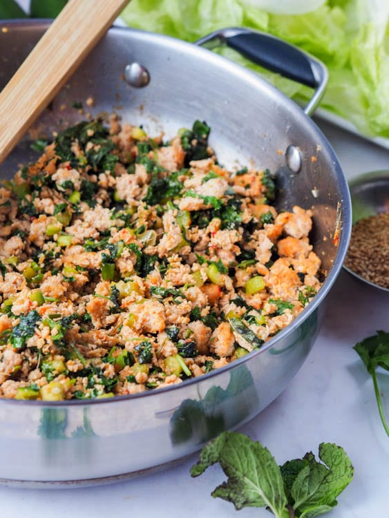 cooked ground chicken with mint, green onion and sauce for the asian chicken lettuce wraps