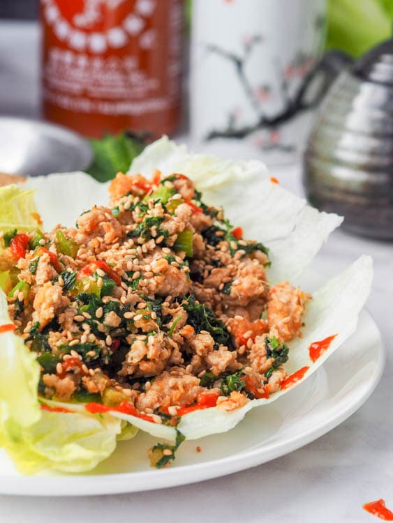 asian chicken lettuce wraps plated