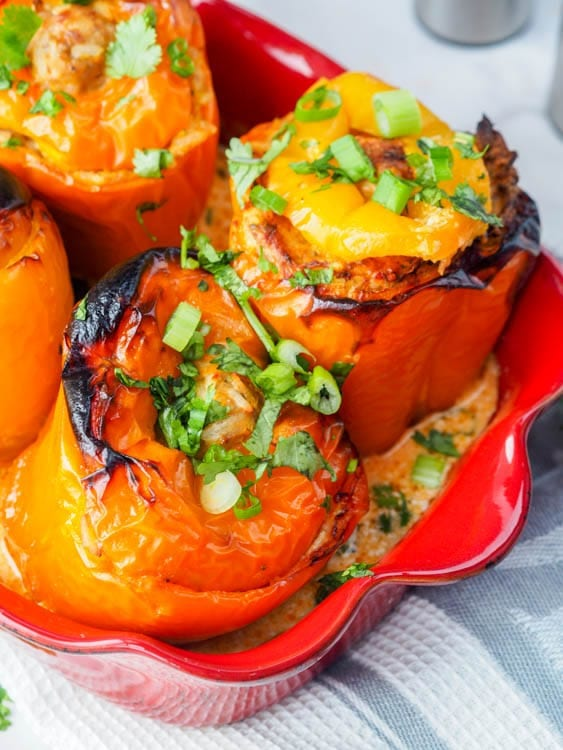 chicken stuffed peppers with rice and carrots close up