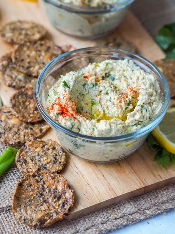 Six ingredient vegan cream cheese that is herb flavored with scallions and cilantro. GF + Paleo too. Makes for a perfect spread or dip for crackers.