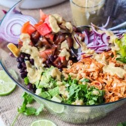 A super filling vegan and gluten free healthy and nutritious salad. Instead of traditional pulled pork, this recipe calls for shredded jackfruit which makes a perfect plant based substitute. This salad is packed full of vitamins and nutrients with romaine, tomatoes, red onions, avocado, black beans and a super-rich and creamy avocado lime based dressing.