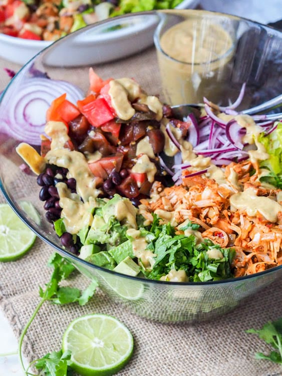 jackfruit pulled pork southwest salad with veggies, beans and avocado sauce
