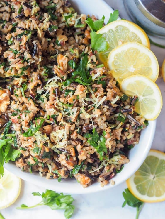 vegan wild rice salad with walnuts, lemons, parsley and nutritional yeast sprinkled with lemon zest
