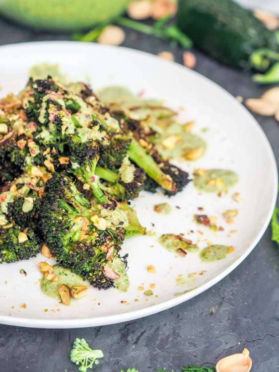 crispy vegan broccoli steaks with pesto and roasted pistachios