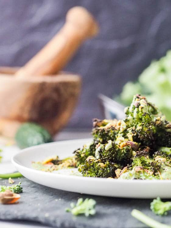 vegan broccoli steaks with pesto and pistachios