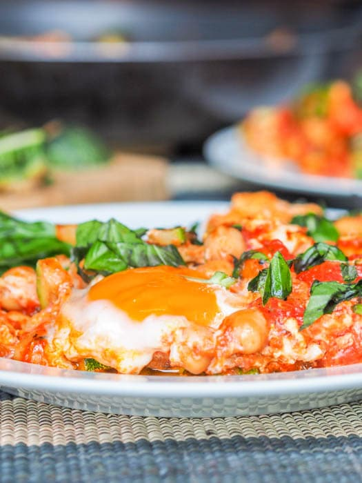 Shakshuka with Eggs, Tomatoes and Chickpeas and a runny egg
