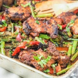One pan chicken and veggies is the perfect low fuss easy weeknight dinner meal. Made with chicken thighs mixed with asparagus, red pepper, red onion, and broccoli. GF, DF & Paleo.