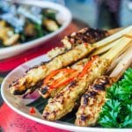 Grilled fish skewers are a traditional Balinese recipe made with tuna mashed with spices and Balinese paste, then formed into patties and grilled. The perfect summer recipe that is packed full of flavor.