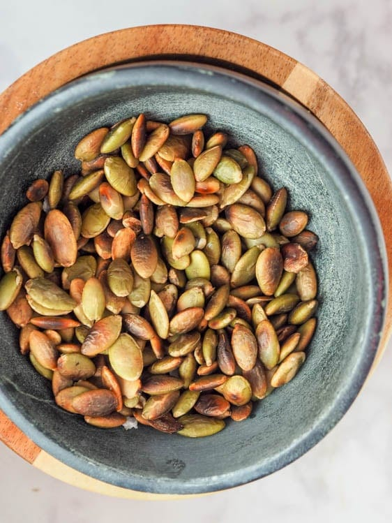 toasted pumpkin seeds in a bowl