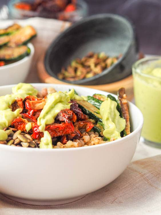 Sorghum Buddha Bowl drizzled with creamy avocado sauce