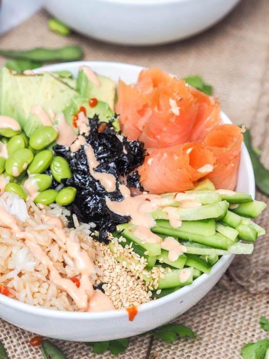 Sushi bowls with smoked salmon, avocado, cucumbers, edamame and rice