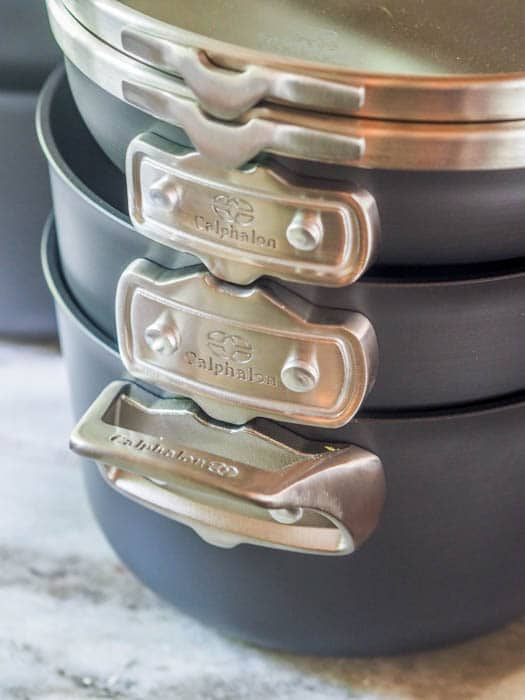 Calphalon Premier Space Saving Nonstick Cookware stacked to show the brand label