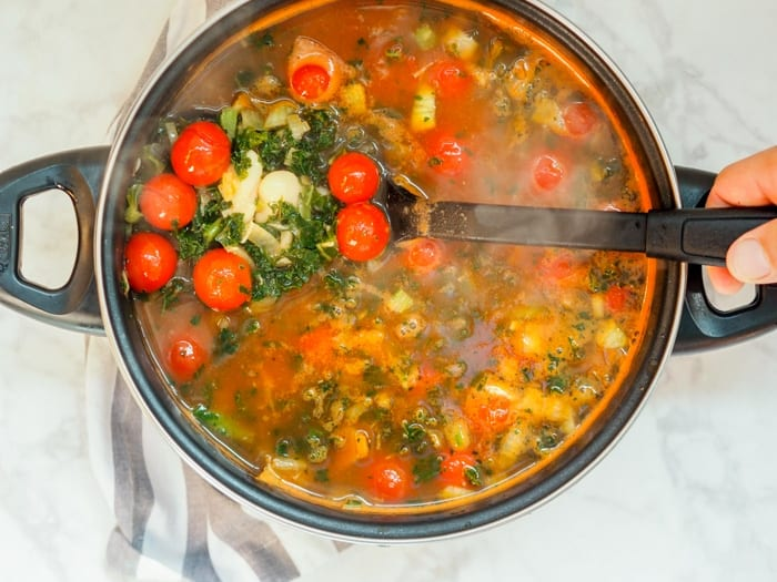 White Bean Kale Soup boiling on the stovetop