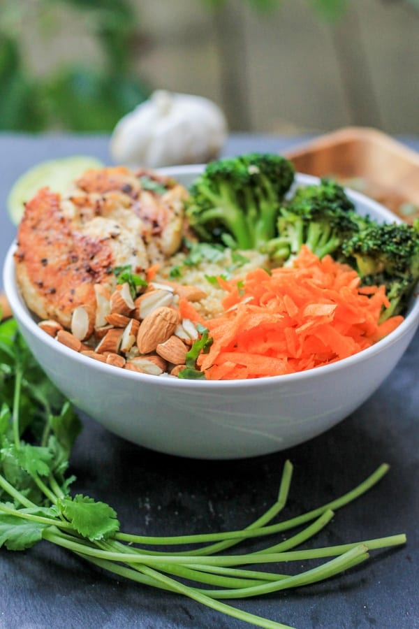 chicken quinoa bowl with shredded carrots and broccoli