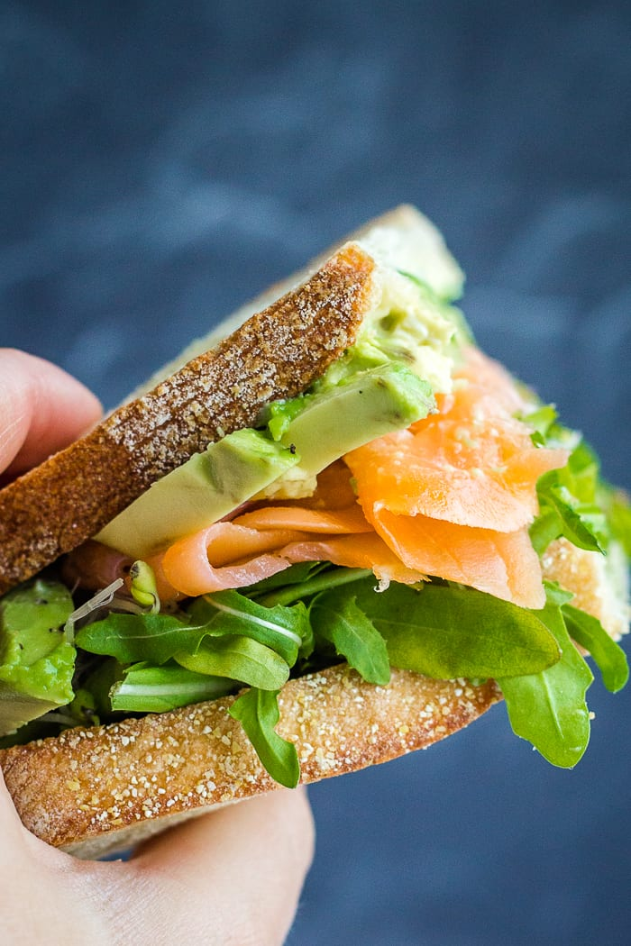 handheld smoked salmon sandwich