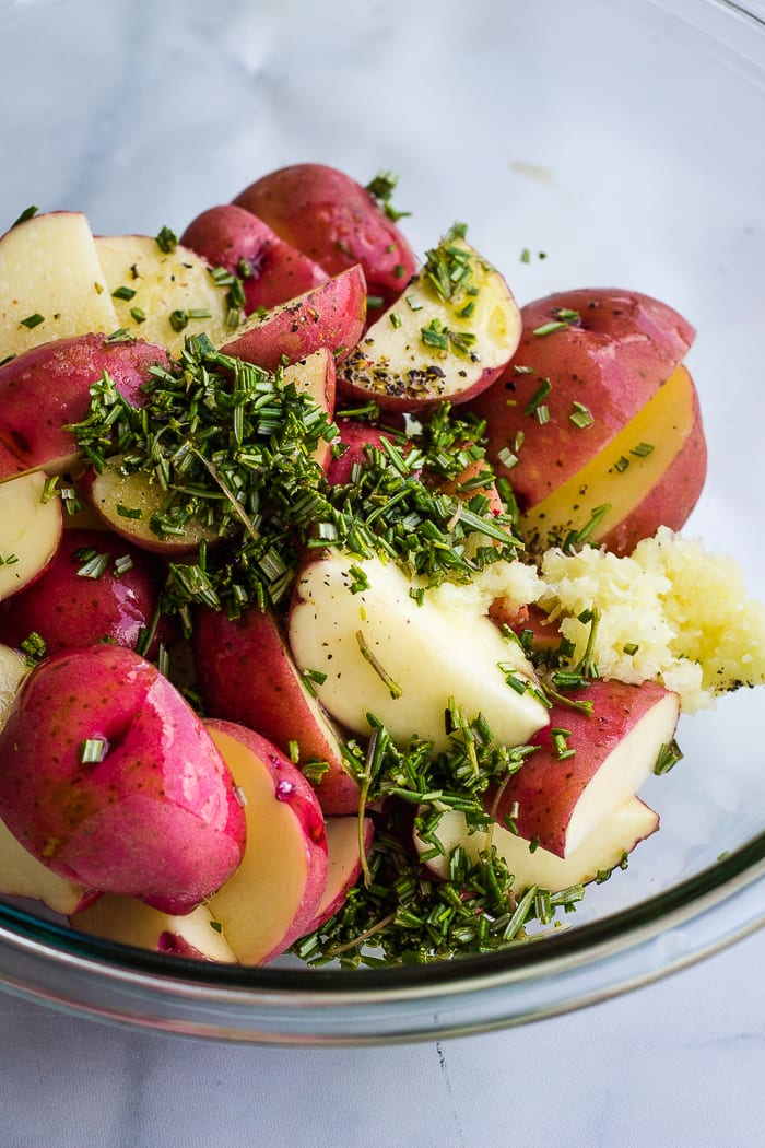 Raw red potatoes with seasoning