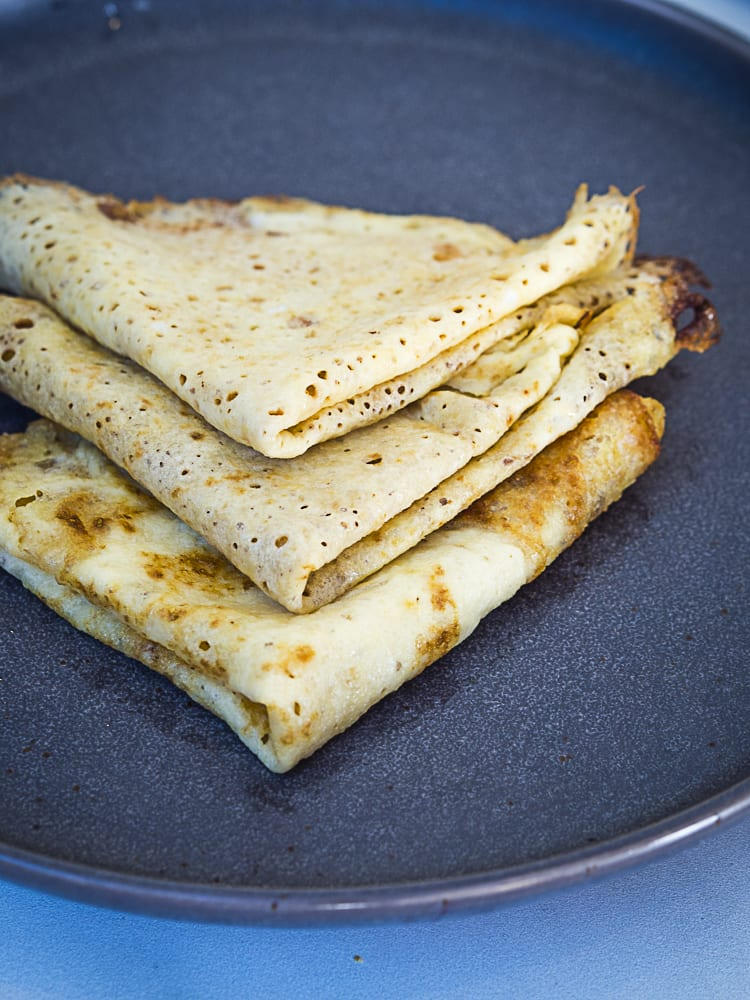 crepes folded into triangles on a plate